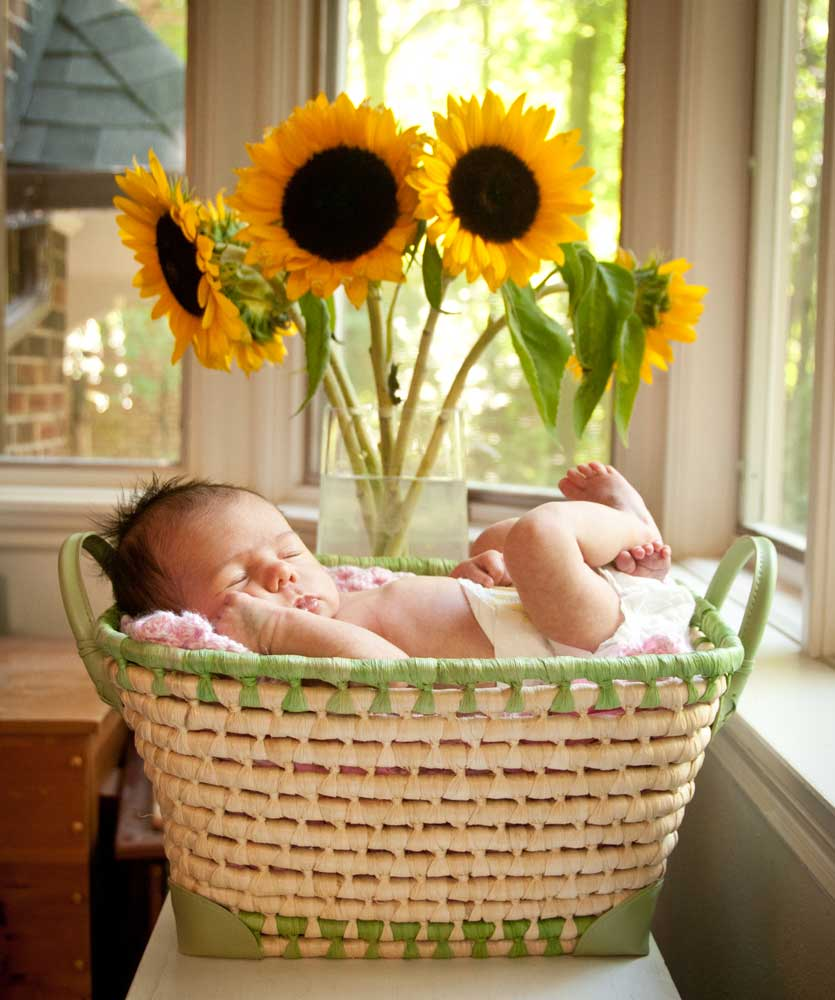 Baby with sunflowers